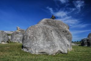 Steffen sitting on a big rock
